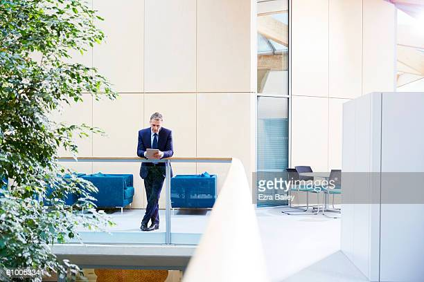 Businessman using a tablet in modern office.