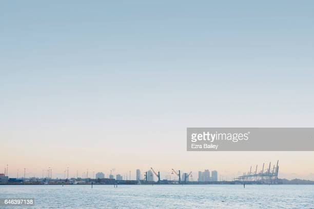 Sunrise over an industrial port in Miami