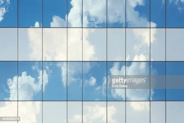 Blue sky reflected in a glass building