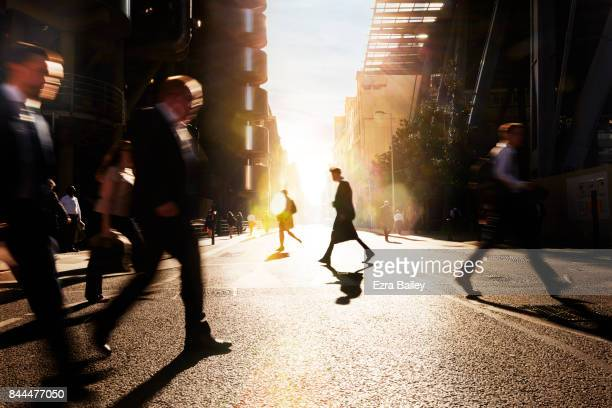 Silhouette of a businessman walking through the city.