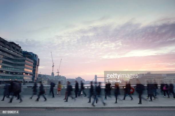 Business people walking through the city at dawn.