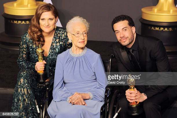 Ezra Edelman Caroline Waterlow and Katherine Johnson attend the 89th Annual Academy Awards Press Room at Hollywood Highland Center on February 26...