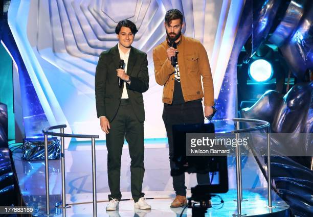 Ezra Koenig and Christopher Tomson of Vampire Weekend speak onstage during the 2013 MTV Video Music Awards at the Barclays Center on August 25 2013...
