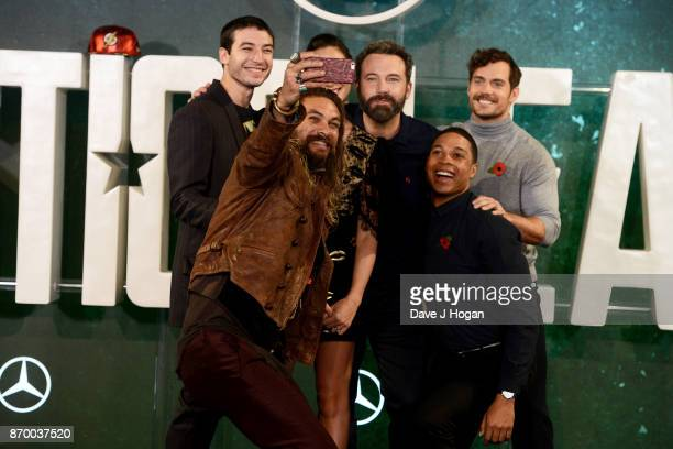 Ezra Miller Jason Momoa Gal Gadot Ben Affleck Ray Fisher and Henry Cavill attend the 'Justice League' photocall at The College on November 4 2017 in...
