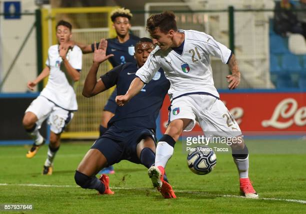 Ezri Konsa of England U20 competes for the ball with Simone Minelli of Italy U21 during the 8 Nations Tournament match between Italy U20 and England...