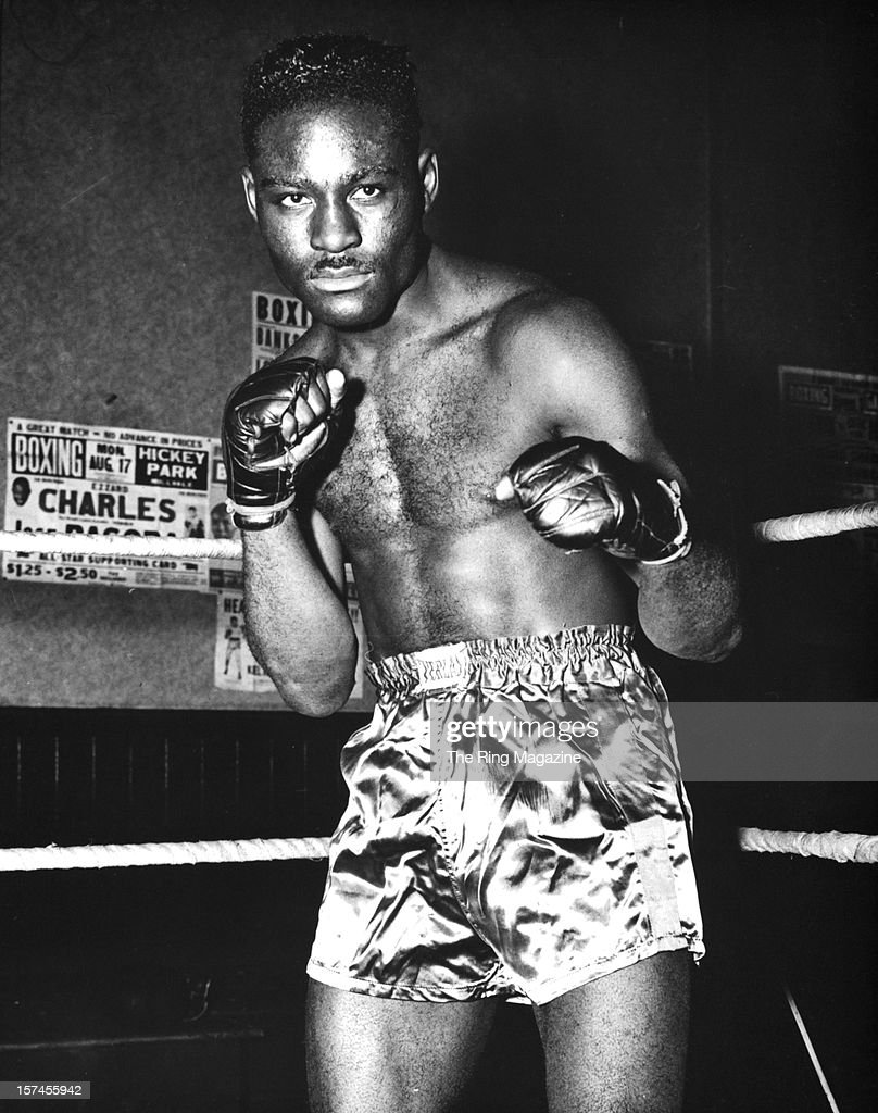 <a gi-track='captionPersonalityLinkClicked' href=/galleries/search?phrase=Ezzard+Charles&family=editorial&specificpeople=215068 ng-click='$event.stopPropagation()'>Ezzard Charles</a> poses as he trains.