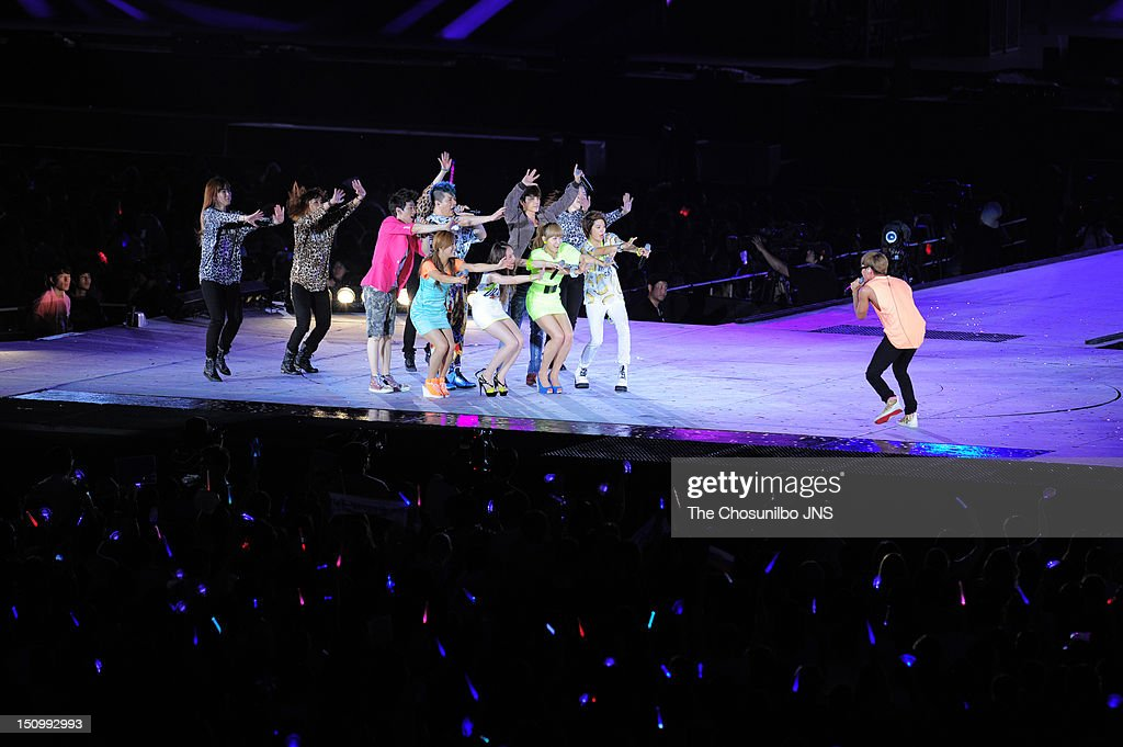 f(x) and <a gi-track='captionPersonalityLinkClicked' href=/galleries/search?phrase=Super+Junior&family=editorial&specificpeople=561135 ng-click='$event.stopPropagation()'>Super Junior</a> perform during 'SM Town Live World Tour 3 In Seoul' at Jamsil Sports Complex on August 18, 2012 in Seoul, South Korea.