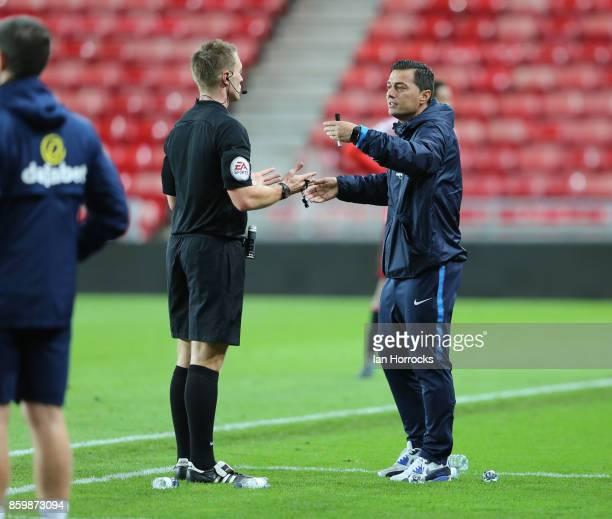f Hertha Berlin coach Ante Covic talks to the referee during the Premier League International Cup match between Sunderland U23 and Hertha Berlin U23...