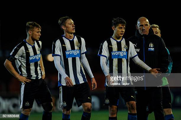 f Newcastle's Academy Coach Dave Watson congratulates players seen LR Ben Pollock Sean Longstaff and Lewis McNall after winning the U18 FA Youth Cup...