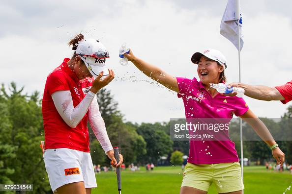 EunHee Ji of South Korea douses Chella Choi of South Korea with water after Choi won her first tournament in a playoff with Ha Na Jang of South Korea...