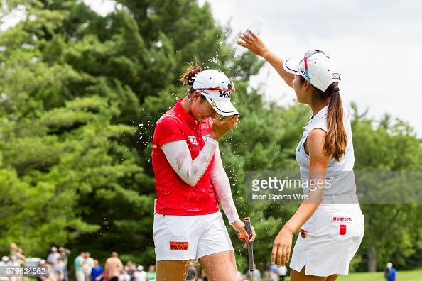 Mi Hyang Lee of South Korea douses Chella Choi of South Korea with water after Choi won her first tournament in a playoff with Ha Na Jang of South...