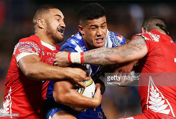 Fa'amanu Brown of Samoa is tackled during the International Rugby League Test match between Tonga and Samoa at Pirtek Stadium on May 7 2016 in Sydney...