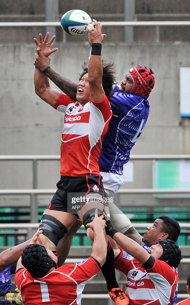 Faatiga Lemalu (R) of Samoa battles for the ball with <a gi-track='captionPersonalityLinkClicked' href=/galleries/search?phrase=Takashi+Kikutani&family=editorial&specificpeople=563879 ng-click='$event.stopPropagation()'>Takashi Kikutani</a> (L) in the air during their match in the Pacific Nations Cup rugby tournament in Tokyo on June 17, 2012. Samoa won the title of the tournament after defeating Japan 27-26. AFP PHOTO/Rie Ishii
