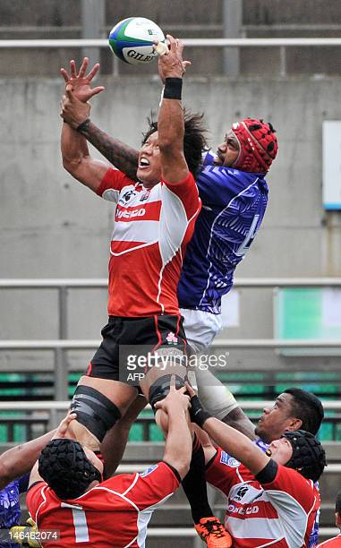 Faatiga Lemalu of Samoa battles for the ball with Takashi Kikutani in the air during their match in the Pacific Nations Cup rugby tournament in Tokyo...