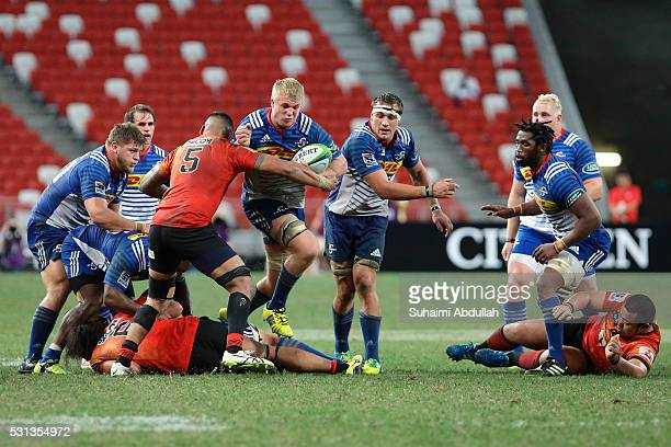 Fa'atiga Lemalu of Sunwolves attempts to tackle PieterSteph Du Toit of Stormers during the round 12 Super Rugby match between the Sunwolves and...