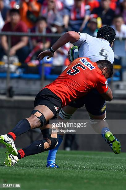 Faatiga Lemalu of Sunwolves makes a tackle on Ross HaylettPetty of Force during the round 11 Super Rugby match between the Sunwolves and the Force at...
