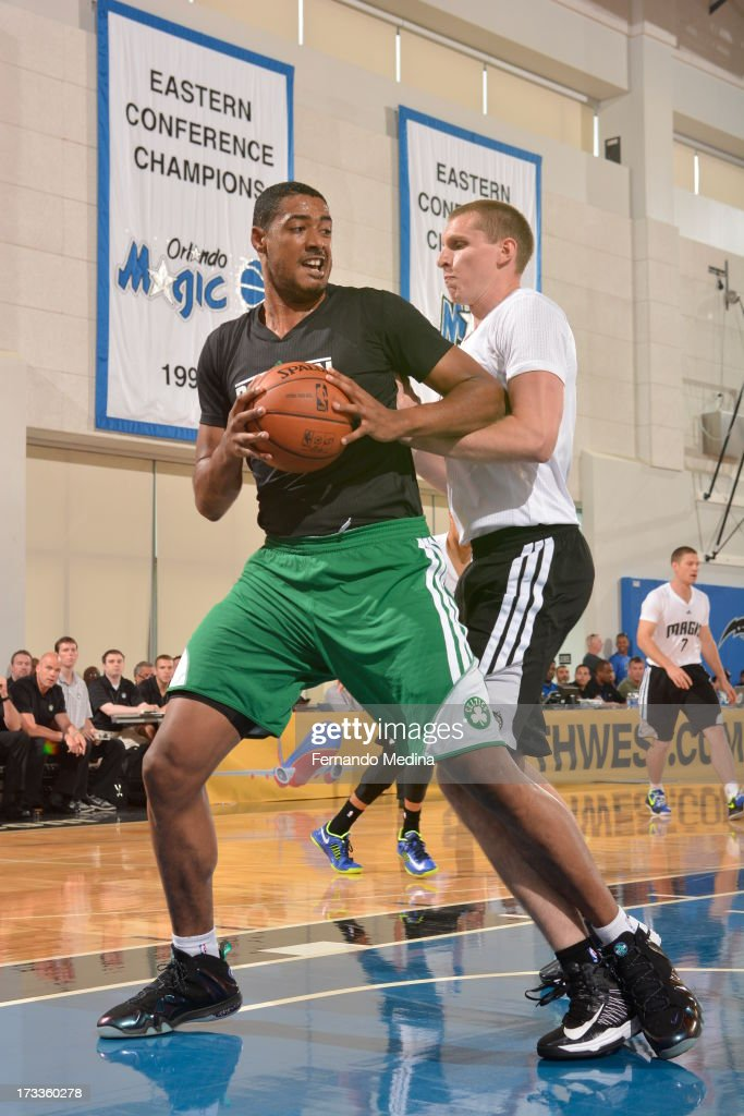 Fab Melo #13 of the Boston Celtics controls the ball against the Orlando Magic during the 2013 Southwest Airlines Orlando Pro Summer League on July 12, 2013 at Amway Center in Orlando, Florida.