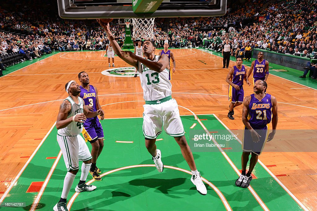 Fab Melo #13 of the Boston Celtics drives to the basket against the Los Angeles Lakers on February 7, 2013 at the TD Garden in Boston, Massachusetts.