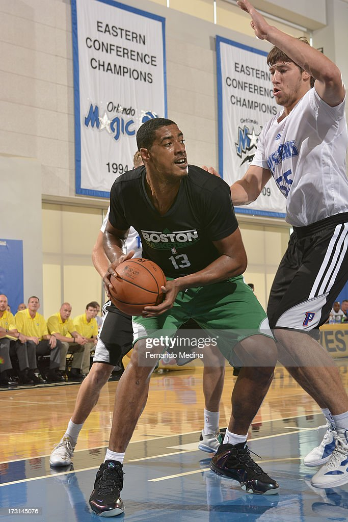 Fab Melo #13 of the Boston Celtics drives under pressure during the 2013 Southwest Airlines Orlando Pro Summer League Game between the Boston Celtics and the Detroit Pistons on July 8, 2013 at Amway Center in Orlando, Florida.