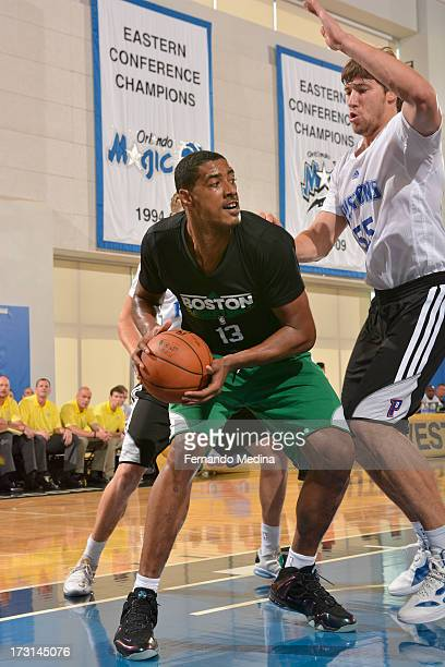 Fab Melo of the Boston Celtics drives under pressure during the 2013 Southwest Airlines Orlando Pro Summer League Game between the Boston Celtics and...
