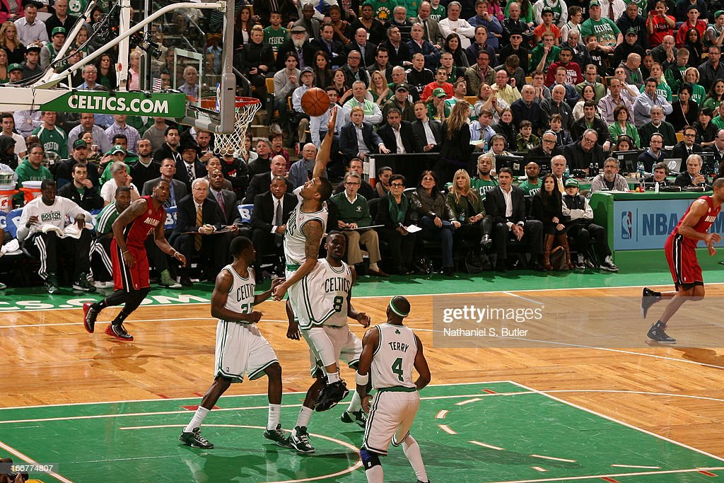 Fab Melo #13 of the Boston Celtics goes up for the dunk against the Miami Heat during a game on March 18, 2013 at TD Garden in Boston, Massachusetts.