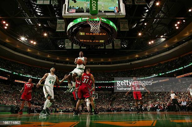 Fab Melo of the Boston Celtics goes up for the easy basket against the Miami Heat during a game on March 18 2013 at TD Garden in Boston Massachusetts...