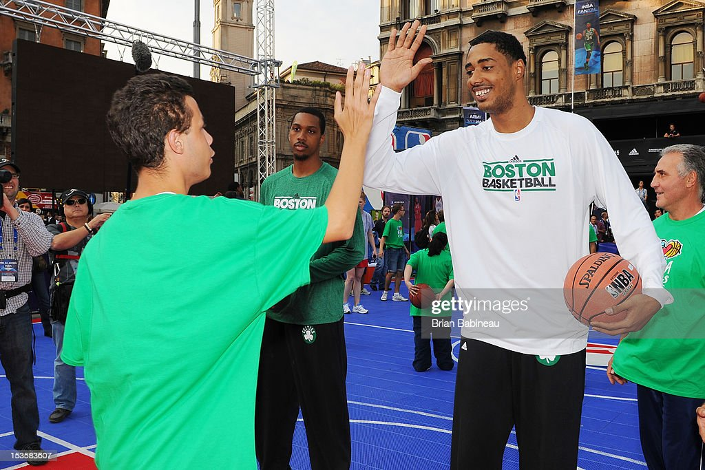 Fab Melo #13 of the Boston Celtics greets participants as the Boston Celtics host an NBA Cares event on October 6, 2012 in Milan, Italy.