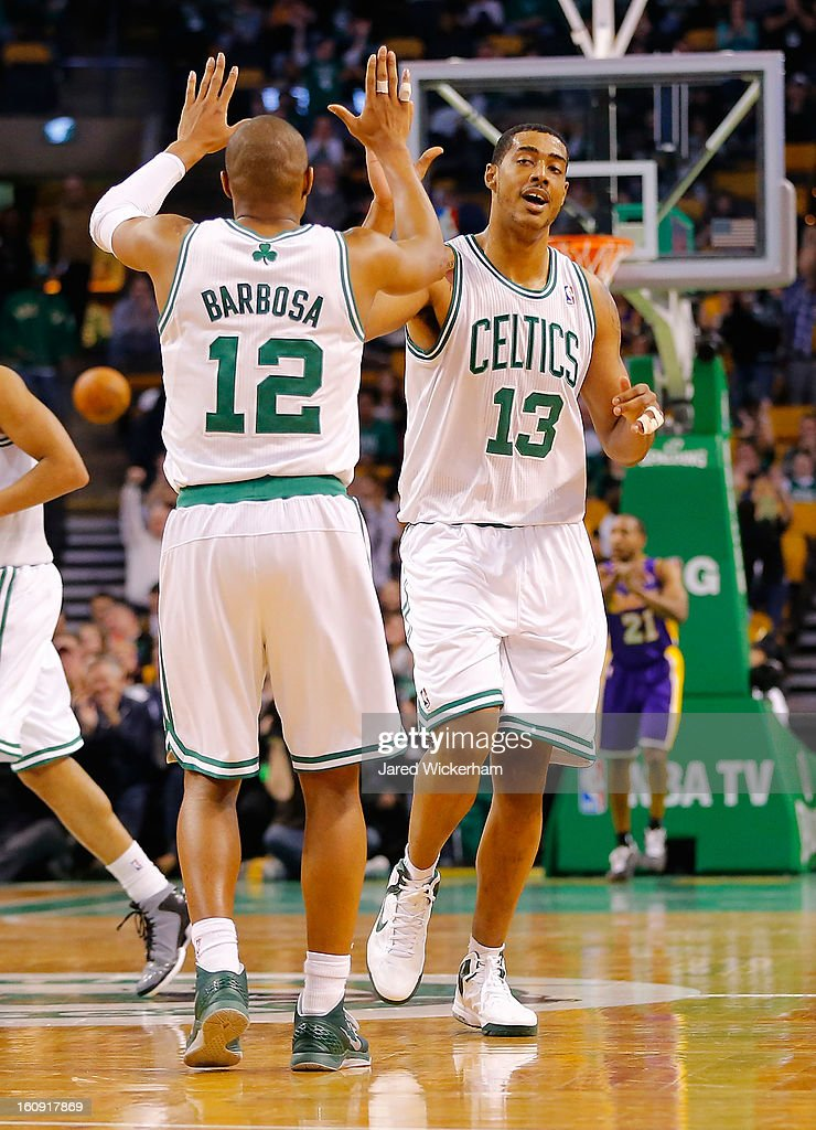 Fab Melo #13 of the Boston Celtics is congratulated by teammate Leandro Barbosa #12 after making a basket in the fourth quarter against the Los Angeles Lakers during the game on February 7, 2013 at TD Garden in Boston, Massachusetts.