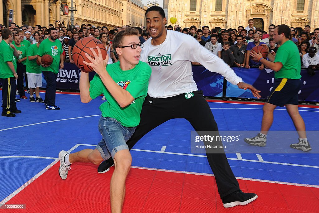 Fab Melo #13 of the Boston Celtics participates in a game with a fan as the Boston Celtics host an NBA Cares event on October 6, 2012 in Milan, Italy.