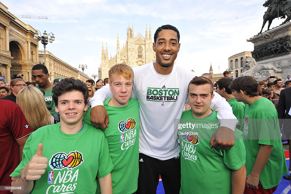 Fab Melo #13 of the Boston Celtics poses for a photo with fans as the Boston Celtics host an NBA Cares event on October 6, 2012 in Milan, Italy.
