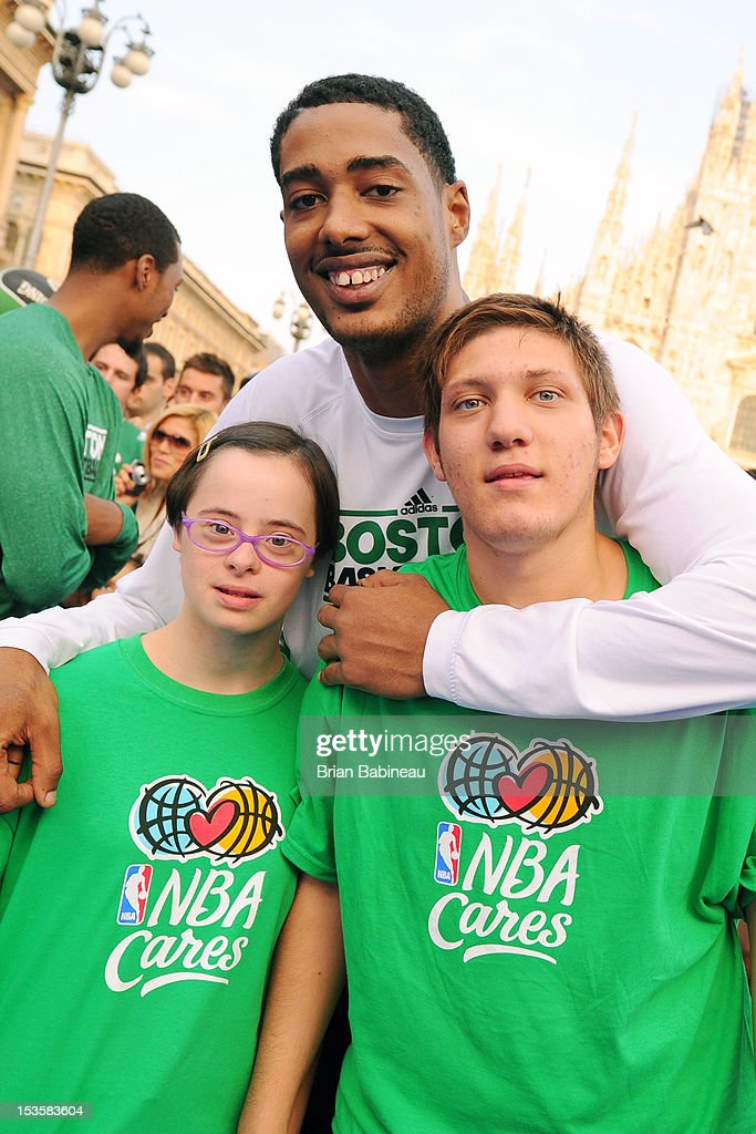 Fab Melo #13 of the Boston Celtics poses for a picture with participants as the Boston Celtics host an NBA Cares event on October 6, 2012 in Milan, Italy.