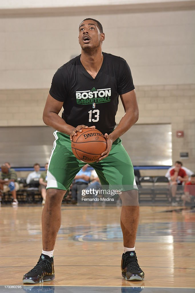 <a gi-track='captionPersonalityLinkClicked' href=/galleries/search?phrase=Fab+Melo&family=editorial&specificpeople=7366439 ng-click='$event.stopPropagation()'>Fab Melo</a> #13 of the Boston Celtics shoots a free throw against the Orlando Magic during the 2013 Southwest Airlines Orlando Pro Summer League on July 12, 2013 at Amway Center in Orlando, Florida.