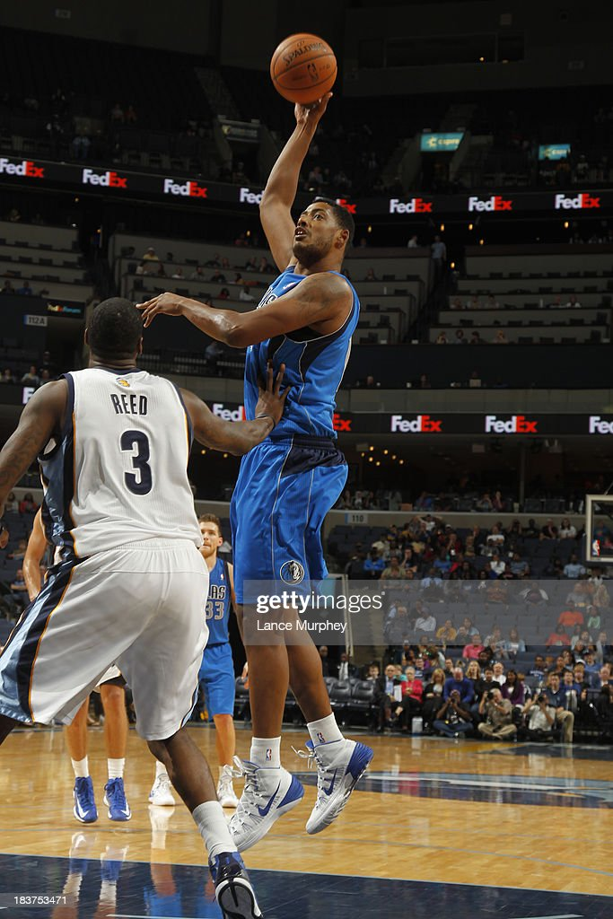 <a gi-track='captionPersonalityLinkClicked' href=/galleries/search?phrase=Fab+Melo&family=editorial&specificpeople=7366439 ng-click='$event.stopPropagation()'>Fab Melo</a> #14 of the Dallas Mavericks shoots against Willie Reed #3 of the Memphis Grizzlies during a game on October 9, 2013 at FedExForum in Memphis, Tennessee.