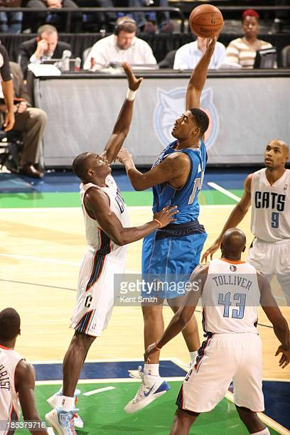 Fab Melo of the Dallas Mavericks shoots the hook shot against Bismack Biyombo of the Charlotte Bobcats at the Greensboro Coliseum on October 19 2013...