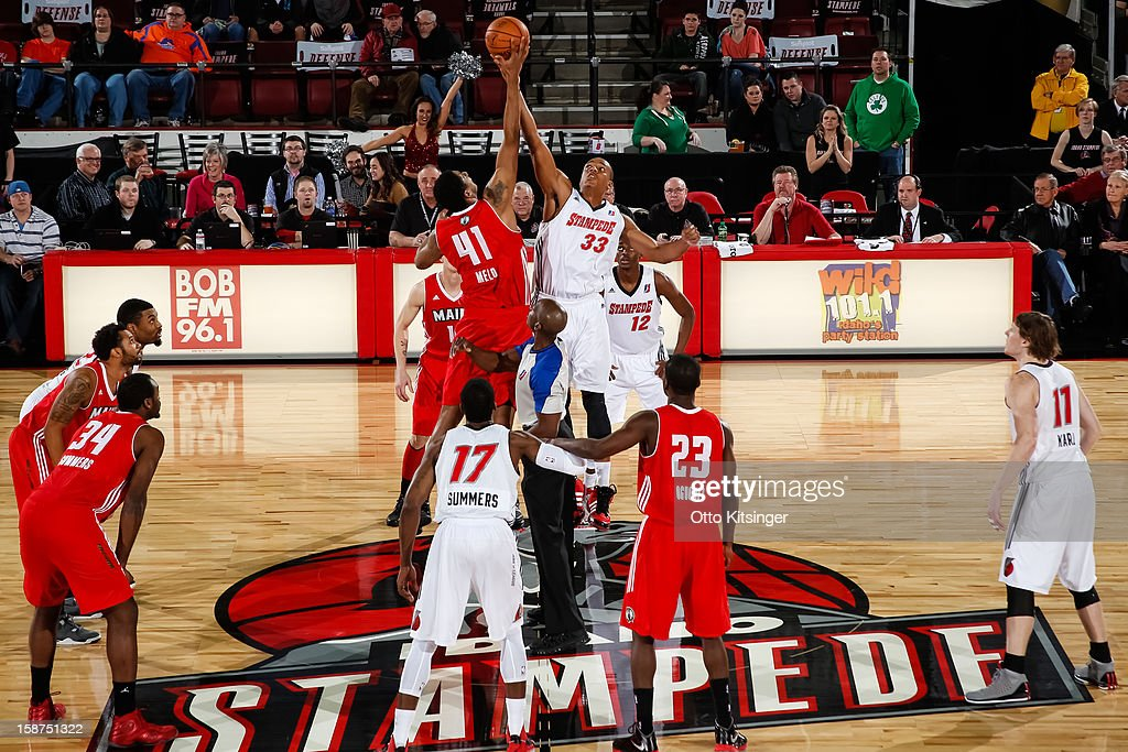 <a gi-track='captionPersonalityLinkClicked' href=/galleries/search?phrase=Fab+Melo&family=editorial&specificpeople=7366439 ng-click='$event.stopPropagation()'>Fab Melo</a> #41 of the Maine Red Claws and <a gi-track='captionPersonalityLinkClicked' href=/galleries/search?phrase=Josh+Owens&family=editorial&specificpeople=4955635 ng-click='$event.stopPropagation()'>Josh Owens</a> #22 of the Idaho Stampede go up for the opening tip off during the NBA D-League game on December 26, 2012 at CenturyLink Arena in Boise, Idaho. Melo was on assignment from the Boston Celtics.