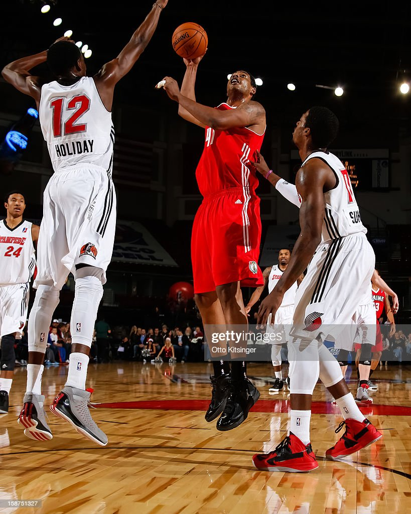 Fab Melo #41 of the Maine Red Claws shoots over Justin Holiday #12 of the Idaho Stampede during the NBA D-League game on December 26, 2012 at CenturyLink Arena in Boise, Idaho. Melo was on assignment from the Boston Celtics.