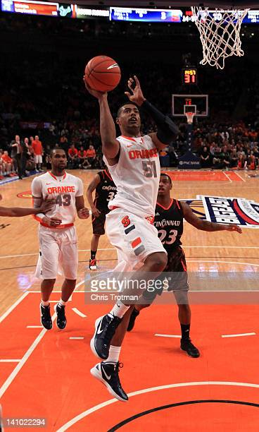 Fab Melo of the Syracuse Orange drives to the basket against the Cincinnati Bearcats during the semifinals of the Big East men's basketball...