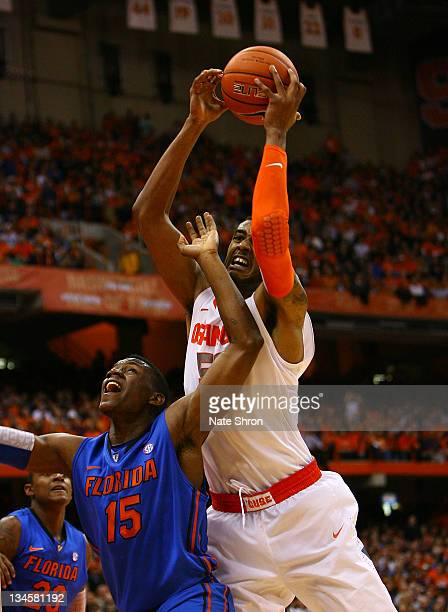 Fab Melo of the Syracuse Orange drives to the basket against Will Yeguette of the Florida Gators during the game at the Carrier Dome on December 2...