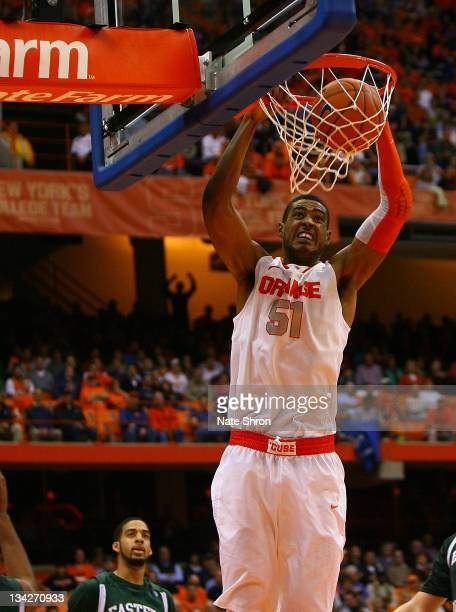 Fab Melo of the Syracuse Orange dunks the ball against the Eastern Michigan Eagles during the game at the Carrier Dome on November 29 2011 in...