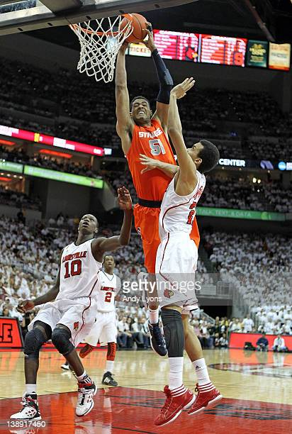 Fab Melo of the Syracuse Orange dunks the ball during the Big East Conference game against the Louisville Cardinals at KFC YUM Center on February 13...
