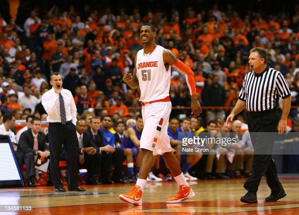 Fab Melo of the Syracuse Orange limps off the court during the game against the Florida Gators during the game at the Carrier Dome on December 2 2011...
