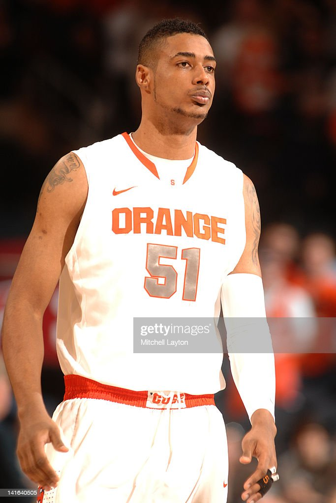 <a gi-track='captionPersonalityLinkClicked' href=/galleries/search?phrase=Fab+Melo&family=editorial&specificpeople=7366439 ng-click='$event.stopPropagation()'>Fab Melo</a> #51 of the Syracuse Orange looks on during a quaterfinal game against the Connecticut Huskies at the 2012 Big East Men's Basketball Tournament at Madison Square Garden on March 8, 2012 in New York, New York. The Orange won 58-55.