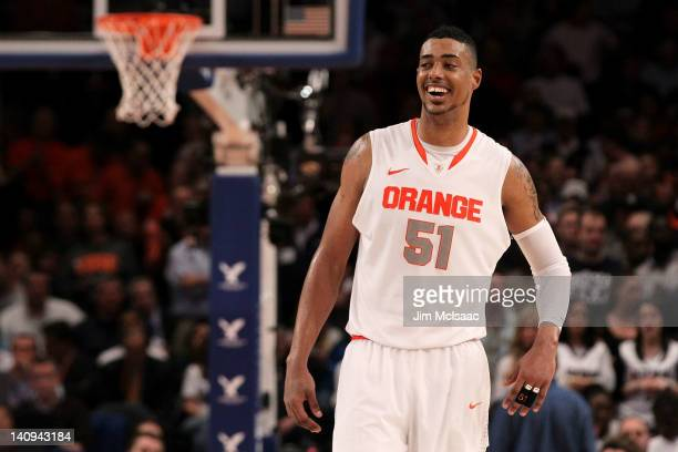 Fab Melo of the Syracuse Orange reacts against the Connecticut Huskies during the quarterfinals of the Big East Men's Basketball Tournament at...