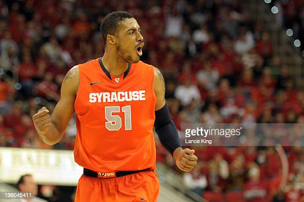 Fab Melo of the Syracuse Orange reacts against the North Carolina State Wolfpack during the first half at the RBC Center on December 17 2011 in...