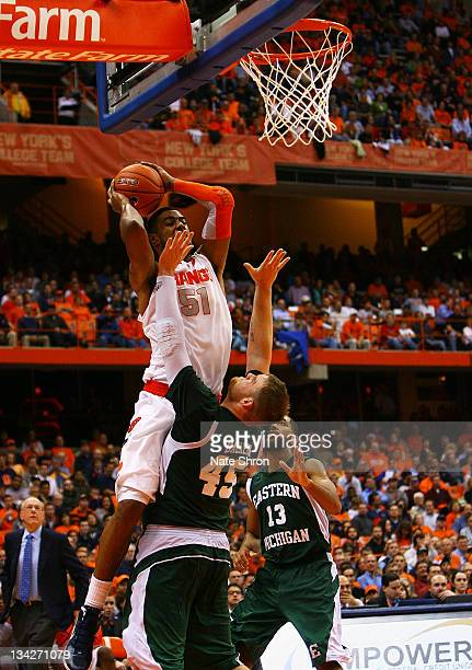 Fab Melo of the Syracuse Orange shoots the ball against Matt Balkema of the Eastern Michigan Eagles during the game at the Carrier Dome on November...