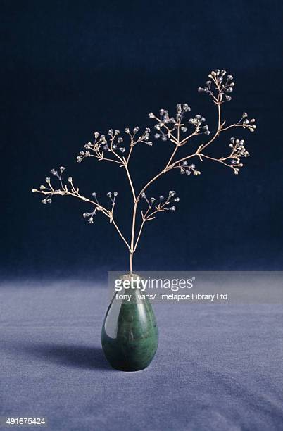 A Fabergé sprig of flowers in a small vase circa 1980