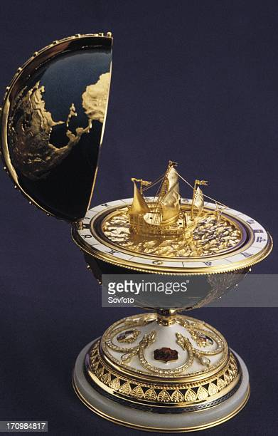Faberge egg in the shape of a globe with a model of a ship inside