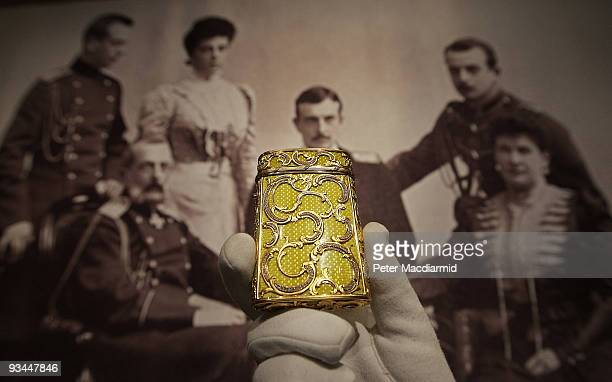 Faberge Imperial enamel cigarette case is displayed n front of a photograph showing Her Imperial Highness Maria Pavlovna Grand Duchess Vladimir and...