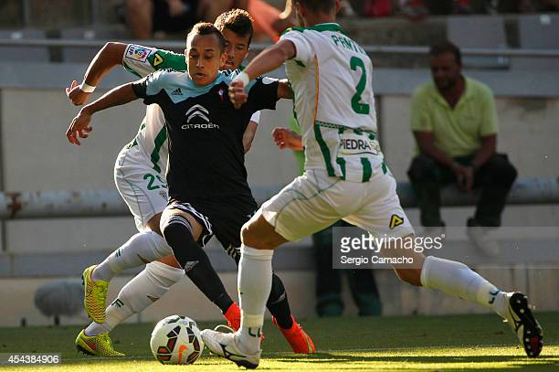 Fabian Ariel Orellana of RC Celta de Vigo beats Daniel Pinillos Gonzalez and Aleksandar Pantic of Cordoba CF during the La liga match between Cordoba...