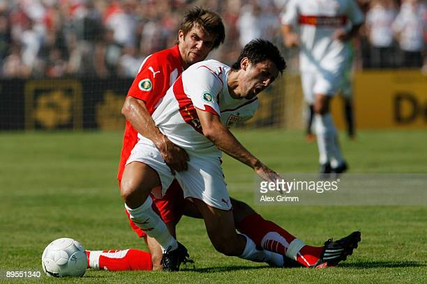Fabian Aupperle of Sonnenhof challenges Ciprian Marica of Stuttgart during the DFB Cup first round match between SG Sonnenhof Grossaspach and VfB...